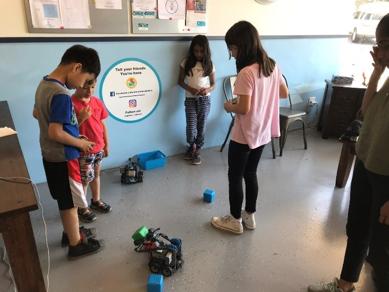 Students completing a Block Challenge with VEX IQ